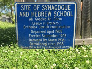 "Sign reading ""Site of Synagogue and Hebrew School"""