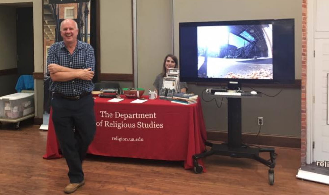 Prof Theodore Trost with graduate student Caity Bell at Religious Studies table