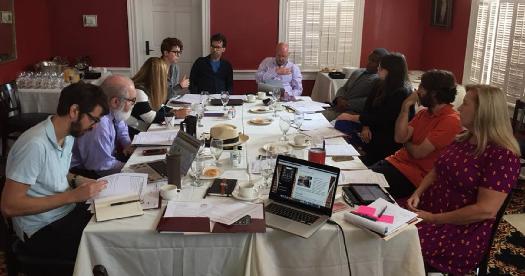 religious studies faculty engaged in a department meeting