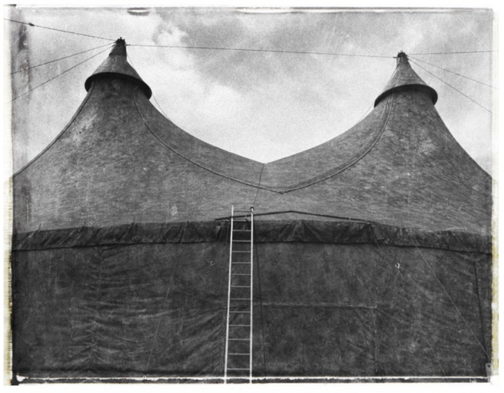 Photo of old curcus tent with two peaks