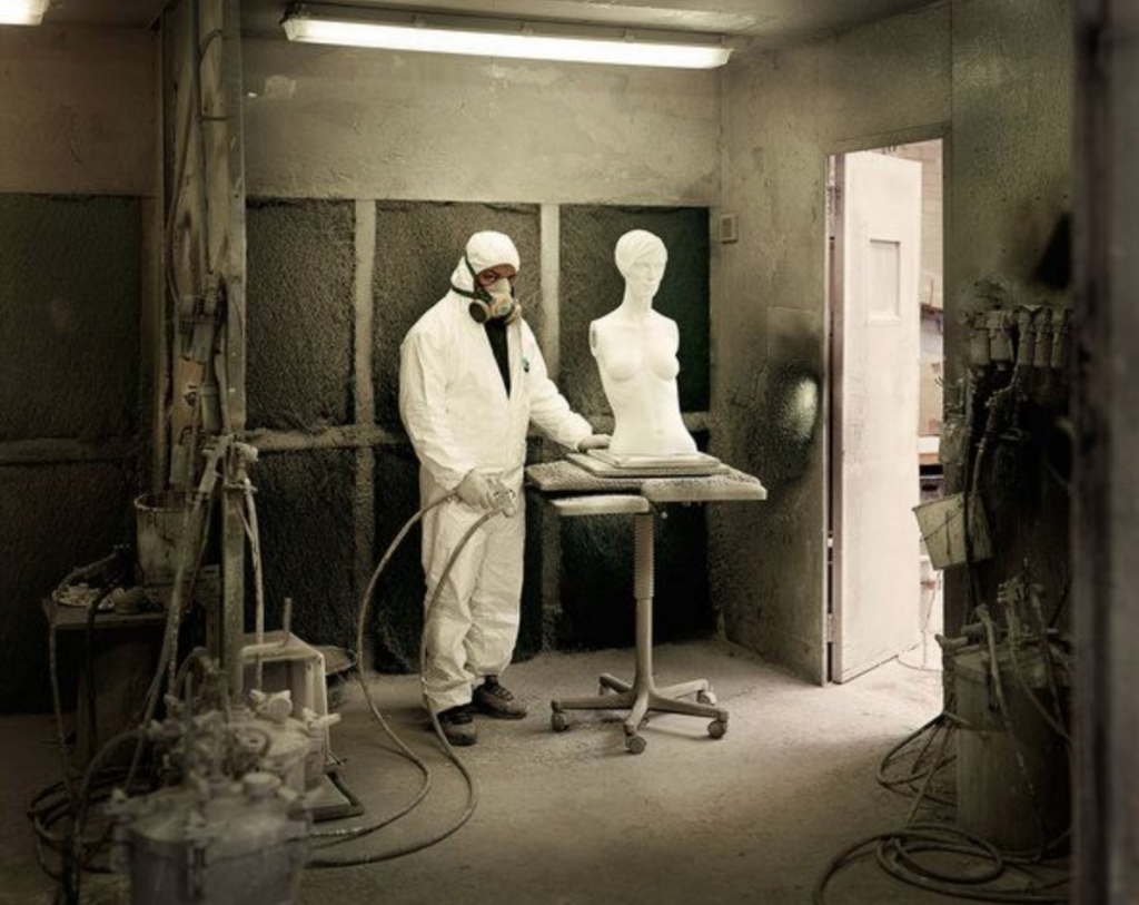 Photo of a man working in a mannequin factory