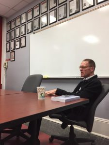Professor Tim Jensen sits in the REL seminar room.
