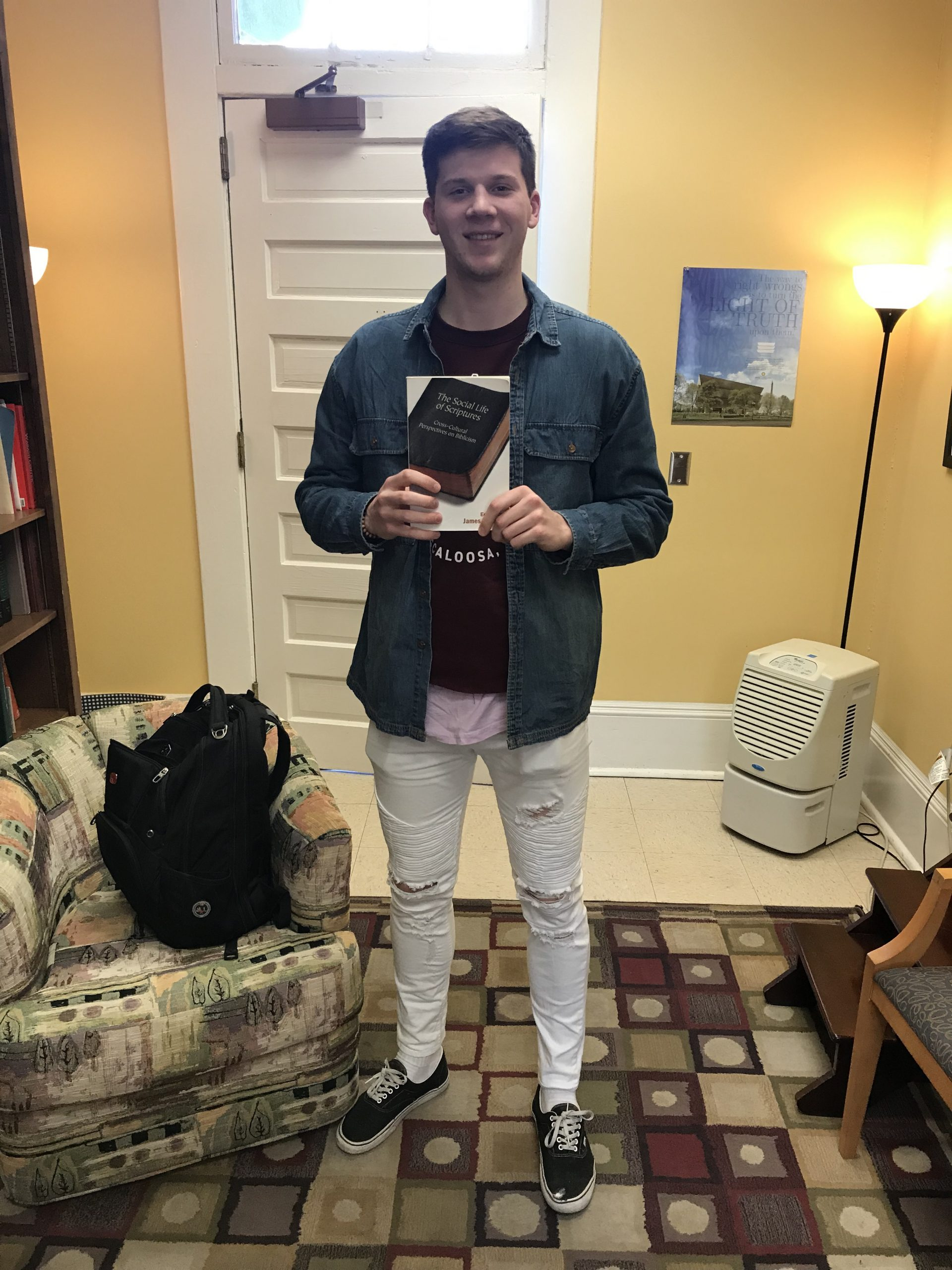 A Picture of Will Watson holding James S. Bielo's book, The Social Life of Scriptures.
