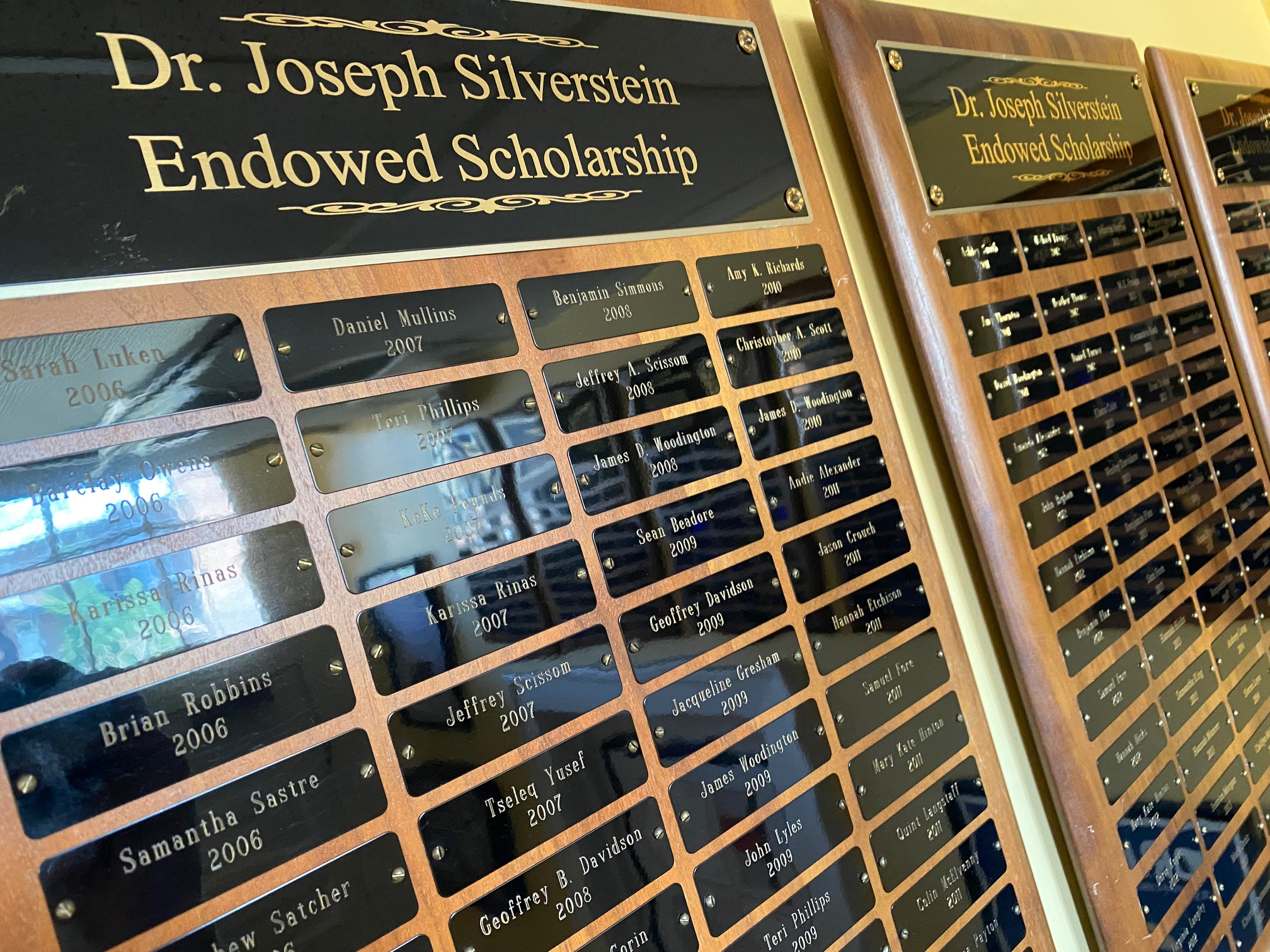 Student award plaques hanging in the department lounge