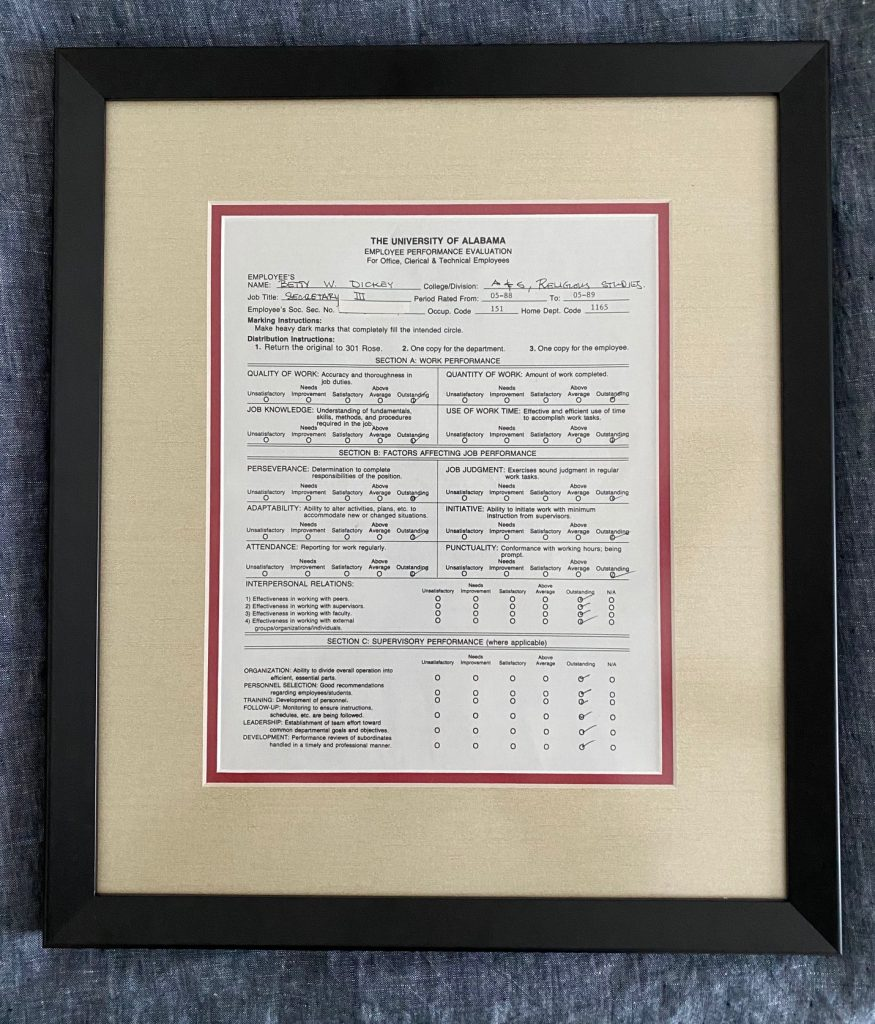 Framed document presented to Betty Dickey as retirement gift