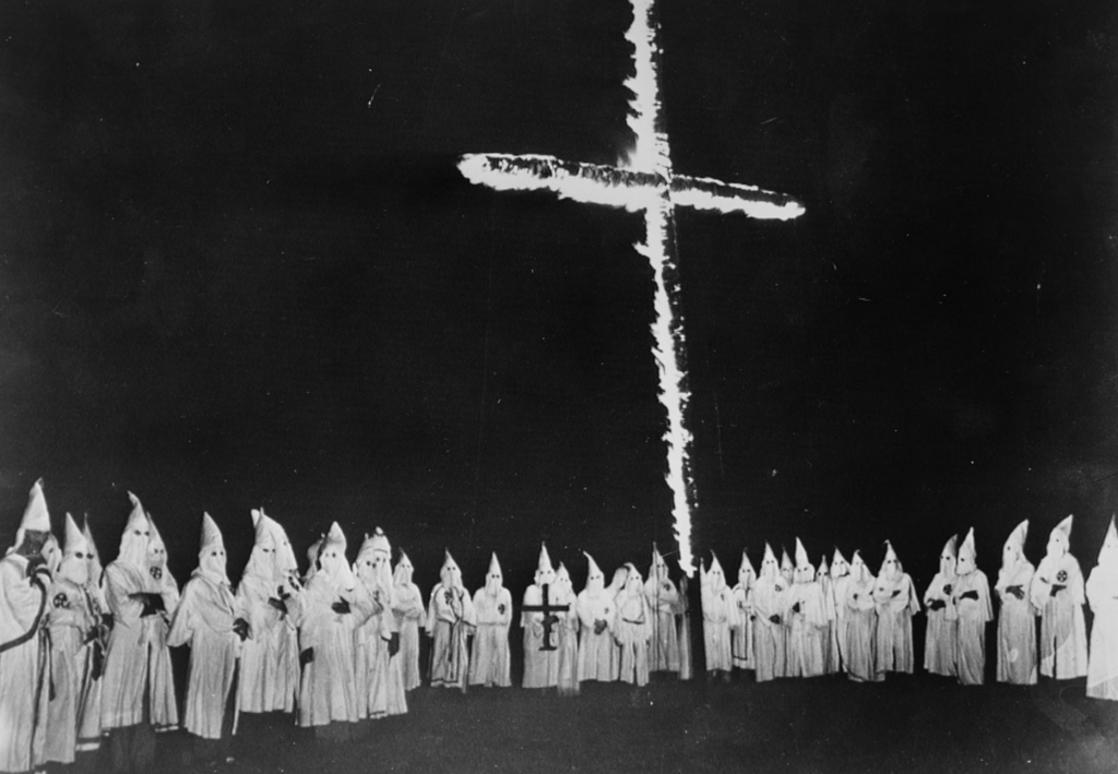 Historical photo of a Ku Klux Klan Rally and Flag Burning