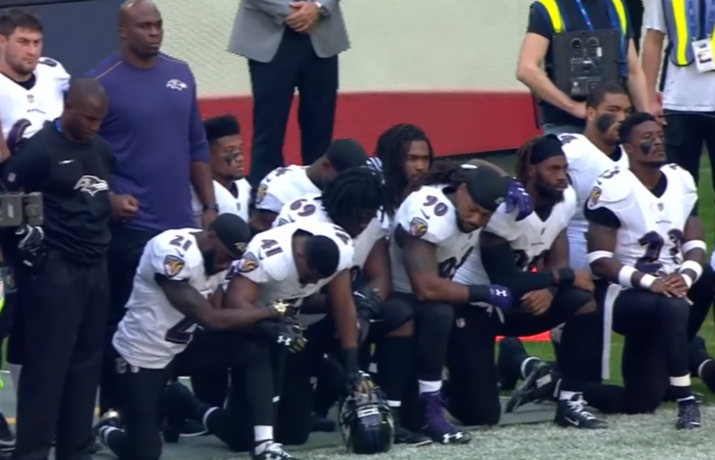 Football players kneeling during the national anthem