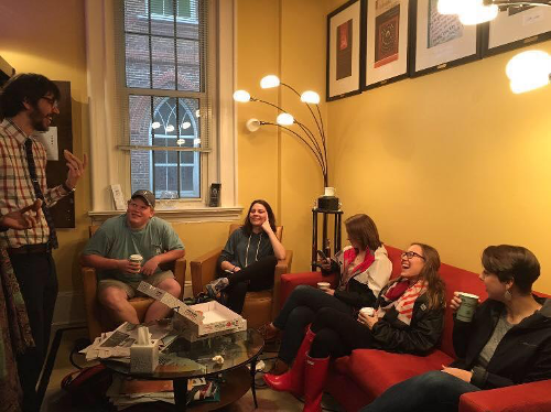 Students and faculty in the department lounge during a coffee break