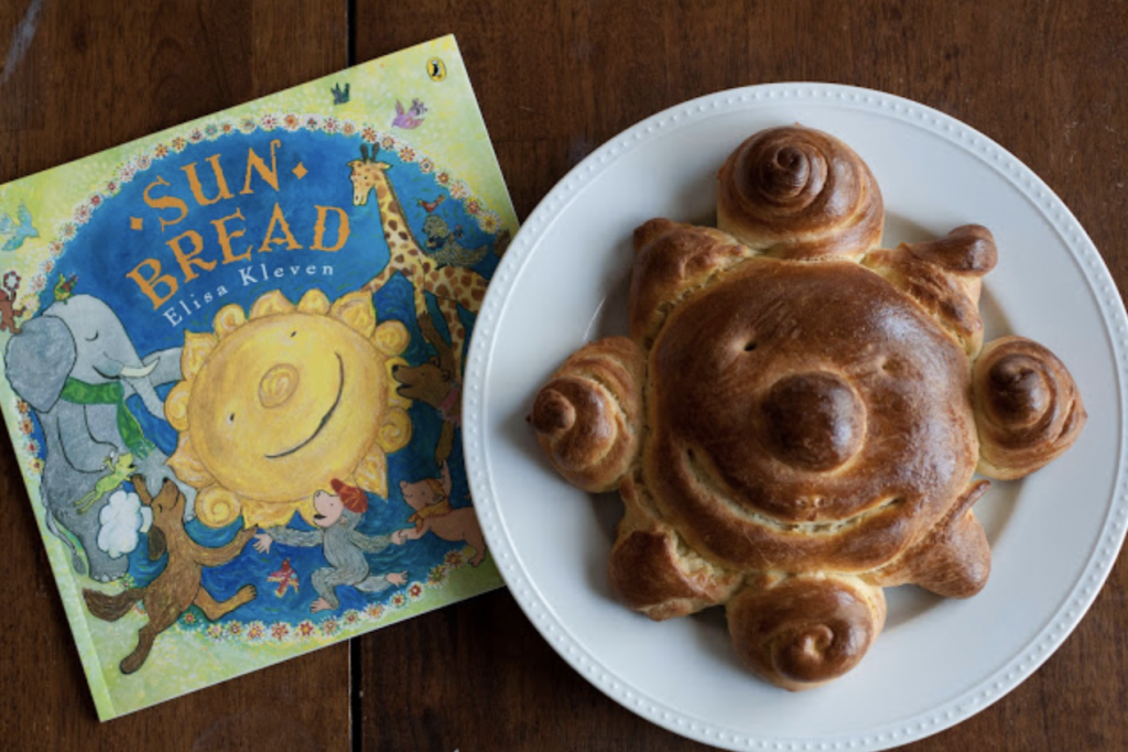 baked sun bread beside the book Sun Bread, by Elisa Klaven
