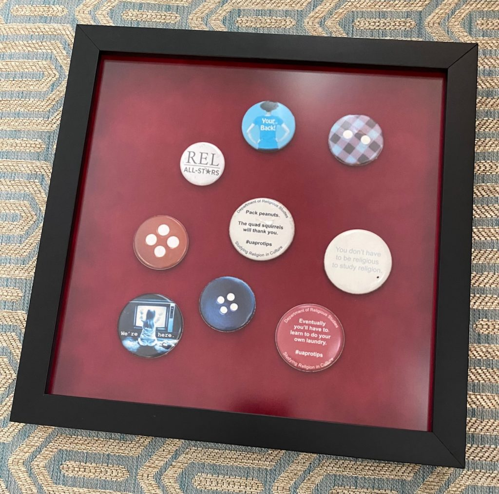 Framed buttons from past REL student events