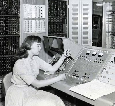 Woman in 1955 working at an early, large computer