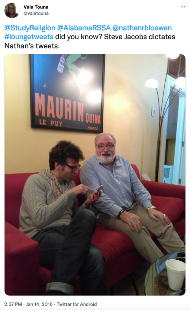 Photo of Prof. Loewen and Jacobs tweeting from the REL Lounge.