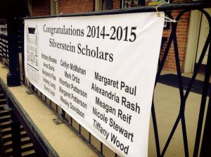 banner showing the names of the 2014-15 Silverstein Scholars on the balcony
