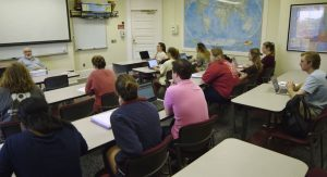 students attend a lecture with Dr. Jacobs