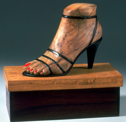 a sculpture of a womans foot wearing a high-heeled shoe