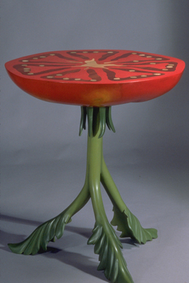 a table that looks like a tomato slice standing on its stem