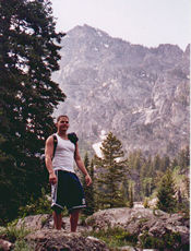 Jason Wright standing in front of a mountain