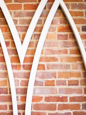 white wooden archway