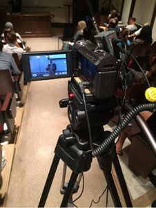 photo of a video camera recording a lecture
