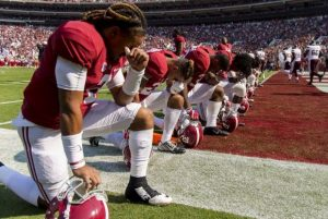 Football Players Praying