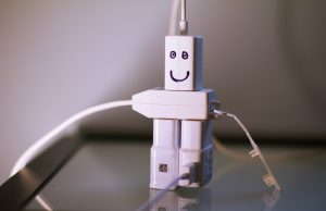cute robot made of usb chargers